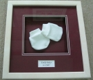 Baby mittens in a 3D frame